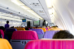 Inside passenger airplan. Travel business trip inside passenger airplan Stock Photography