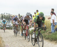 Inside the Peloton on a Cobblestone Road - Tour de France 2015 Royalty Free Stock Photography