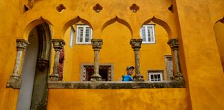 Inside of Pena Palace in Sintra, Lisbon district, Portugal. Orange wall entrance . Stock Photo
