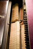 Inside the Piano. Details on the inside of an old antique piano Royalty Free Stock Photography