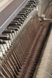 Inside a Piano. Details on the inside of an old antique piano Royalty Free Stock Photos