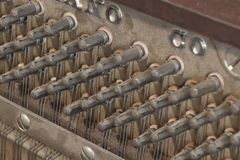 Inside a Piano. Details on the inside of an old antique piano Stock Photography