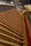 Inside a Piano. Details on the inside of an old antique piano royalty free stock photography