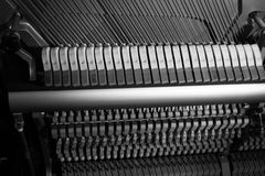 Inside of a piano, hammers and strings Royalty Free Stock Photos