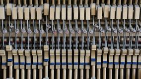 Inside the piano: string, keys and hammers stock video footage