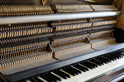 Inside the piano: string, pins and hammers Stock Photo