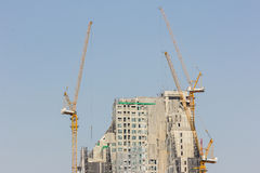Inside place for many tall buildings under construction and cran Royalty Free Stock Image