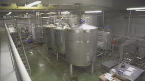 Inside plant for production of dairy products panoramic view. stock footage