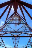 Inside of a power pylon and look into the sun Stock Photo