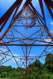 Inside of a power pylon and look into the sun Stock Photos
