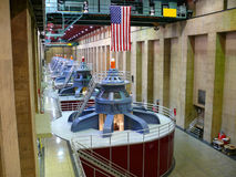 Inside a power station. Huge high capacity electrical generators in line Royalty Free Stock Images