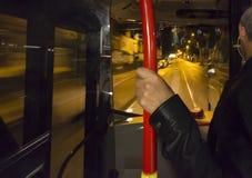Inside Public bus at night. Public bus speeding down the street at night Stock Image