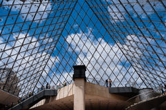 Inside the pyramid of the Louvre Museum Royalty Free Stock Photo