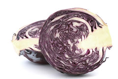 Inside raw red cabbage halves. Close up on white background stock photography