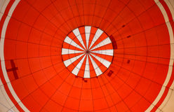 Inside red hot air balloon. From bottom view up to top inside of hot air balloon Royalty Free Stock Photo