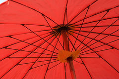 Inside red parasol Stock Photography
