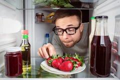 Fresh strawberries in a fridge Stock Photos