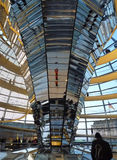 Inside the Reichstag dome, Berlin. Mirrored cone in the Reichstag dome, designed by Sir Norman Foster. The dome's spiral walkway, gives a 360° view of royalty free stock images