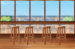 Inside of restaurant with stools and bar Royalty Free Stock Images