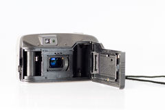 Inside retro film camera. The interior of retro film camera showing, spool , lens, viewfinder, back, catch, cord, sprocket and film guide  on a white background Royalty Free Stock Image
