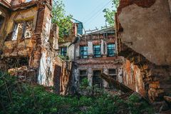 Inside ruined abandoned house building after disaster, war, earthquake or other natural cataclysm Stock Images