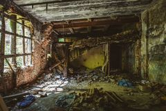 Inside ruined red brick industrial building. Abandoned and destroyed by earthquake, bomb, terrorist attack Royalty Free Stock Images
