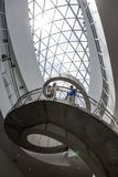 Inside the Salvador Dali Museum. Two museum goers admire the view from the winding staircase under the glass ceiling in the Salvador Dali Museum in St Stock Photos