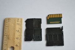 Inside an SD Card with centimeter scale ruler royalty free stock photo