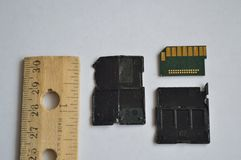 Inside an SD Card with inch scale ruler stock photos
