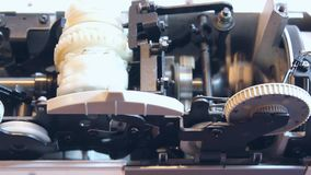 Inside a sewing machine stock video