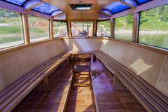 Inside the Ship on lake. Inside small touristic ship name Rak moor to the platform on the Lake in Roznow , Poland. Europe. Space for passengers Royalty Free Stock Image