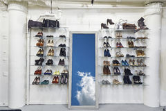 Inside shoe shop and mirror with. Conceptional image to illustrate heaven and freedom when byuing shoes in shop Stock Images