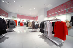 Inside the shop, hall with hanging outerwear Royalty Free Stock Image