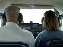 Inside small airplane cockpit. With pilot and passenger Stock Photos