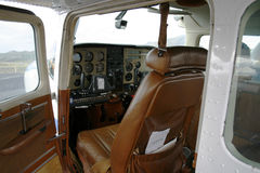 Inside a small plane. Small cesna airplane with open door. Looking into interior and instruments. Instruments out of focus Royalty Free Stock Photo