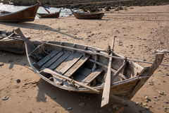 Inside of a small wooden boat at a beach in Royalty Free Stock Image