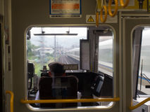 Inside a speeding JR Train in Tokyo, Japan. View from inside a JR train in Tokyo Japan. Fields and houses are visible on the left, while another train speeds Royalty Free Stock Photo