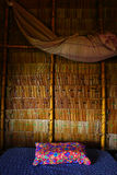 Inside of the staw house with bed and pillow. relax countryside style. Textured background Stock Photo
