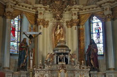 Inside of Sumuleu Church. Transylvania. Jesus Christ, Madonna statue, and two saint kings Stock Images