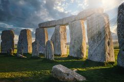 Free Inside The Circle Of Stones At Stonehenge With The Morning Sun Casting Rays Through The Rock Royalty Free Stock Image - 167710916
