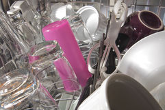 Inside top drawer of a full clean dishwasher Royalty Free Stock Photography