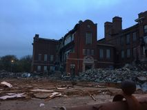Inside of torn down school at night. Inside shot of torn down school taken at dusk, lit dimly by light in foreground royalty free stock photos