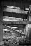 Inside a Torn up building in Bosnia. Black & white photo inside a factory that was destroyed during the Bosnian war. Taken in Brcko, Bosnia and Hercegovina 2009 Royalty Free Stock Image