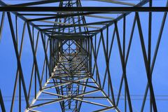 Inside Tower. Looking skyward inside a high tension tower Royalty Free Stock Photography