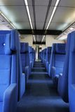 Inside a train. Ground view of vacant seats inside a train during evening hours Royalty Free Stock Images