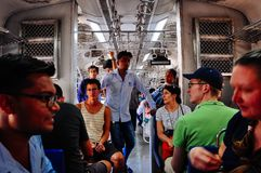 Inside the train in Mumbai, India. Passengers inside the train in Mumbai, India royalty free stock image