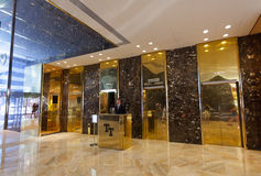 Inside of the Trump Tower, lifts with employee. Stock Image
