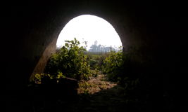 Inside of a tunnel. The patching of dark and light Royalty Free Stock Photo