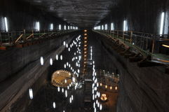 Inside the Turda salt mine. Romania: a tourist attraction also used as therapy for respiratory problems such as bronchities or asthma, having a highly ionized Royalty Free Stock Photo