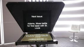 Inside tv news. News politics and sports on the teleprompter stock video footage